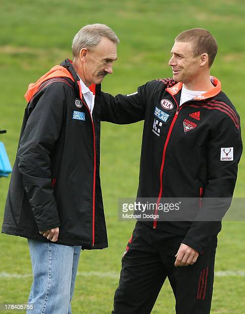 Bombers interim senior coach Simon Goodwin gestures to CEO Ray Gunston during an Essendon Bombers training session at Windy Hill on August 30 2013 in...
