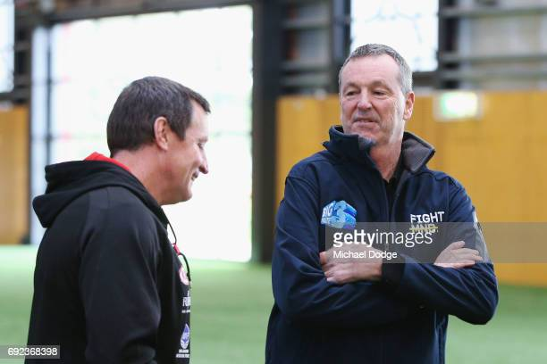 Bombers legend Neale Daniher speaks to Bombers head coach John Worsfold after a cheque presentation to fight MND at the Essendon Football Club on...