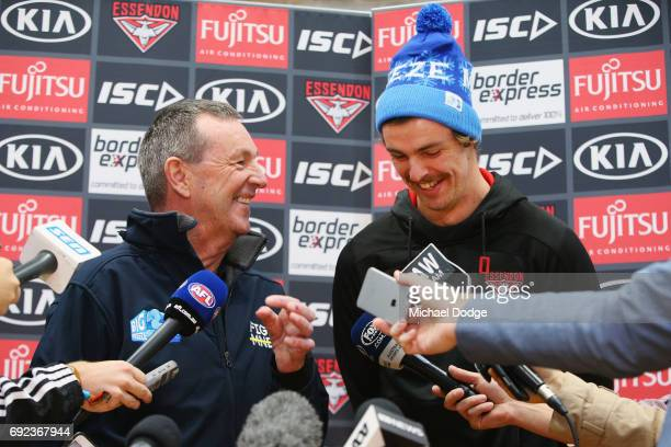 Bombers legend Neale Daniher speaks to media with nephew Joe Daniher of the Bombers during a cheque presentation to fight MND at the Essendon...