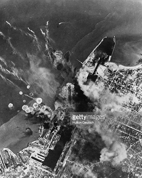 Bombers of the US 8th Army Air Force blast a German U Boat base at St. Nazaire in one of three attacks. Bombs are blasting installations from which...