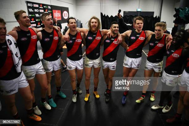 Bombers players celebrate victory and sing the club song after the round 10 AFL match between the Greater Western Sydney Giants and the Essendon...