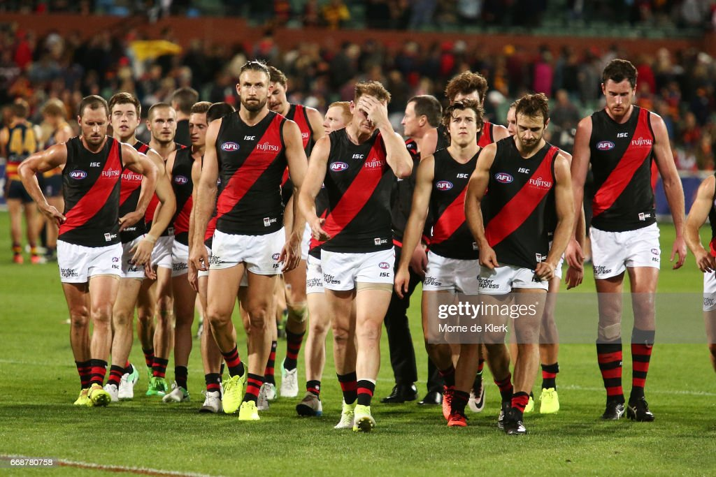Bombers players come from the field after losing the round four AFL match between the Adelaide Crows and the Essendon Bombers at Adelaide Oval on April 15, 2017 in Adelaide, Australia.