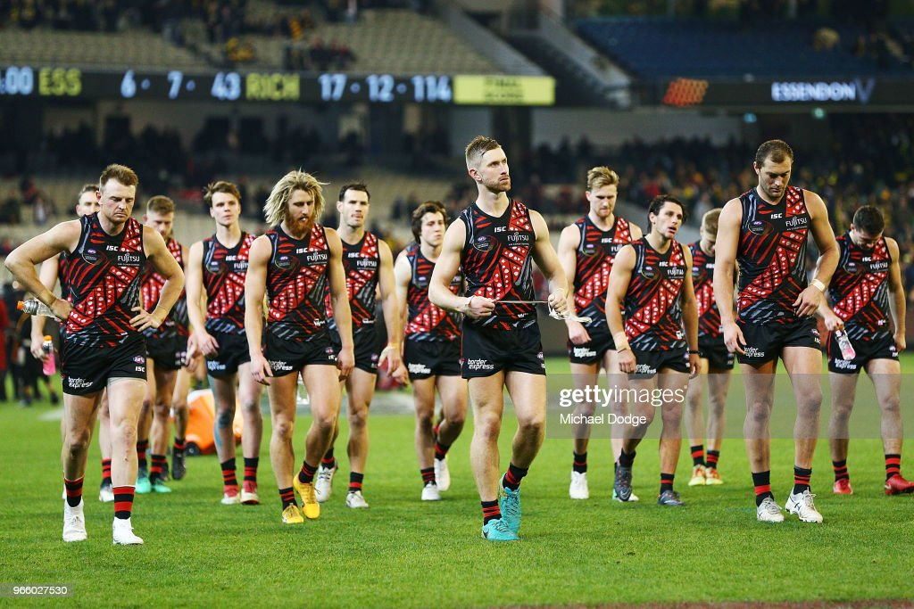 Bombers players dejected after defeat during the round 11 AFL match between the Essendon Bombers and the Richmond Tigers at Melbourne Cricket Ground on June 2, 2018 in Melbourne, Australia.