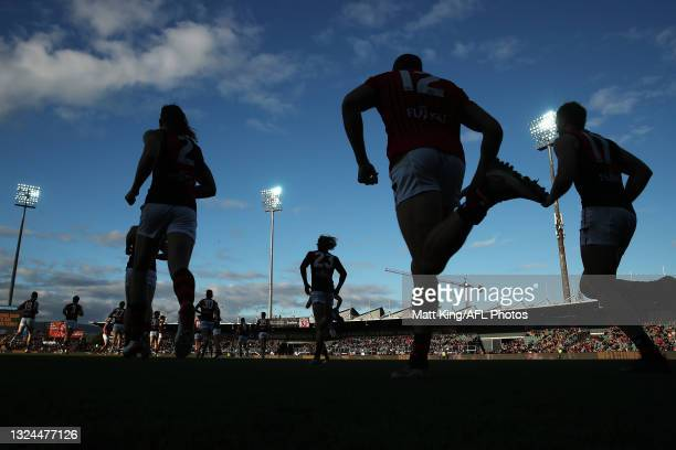 Bombers players take to the field during the round 14 AFL match between the Hawthorn Hawks and the Essendon Bombers at University of Tasmania Stadium...