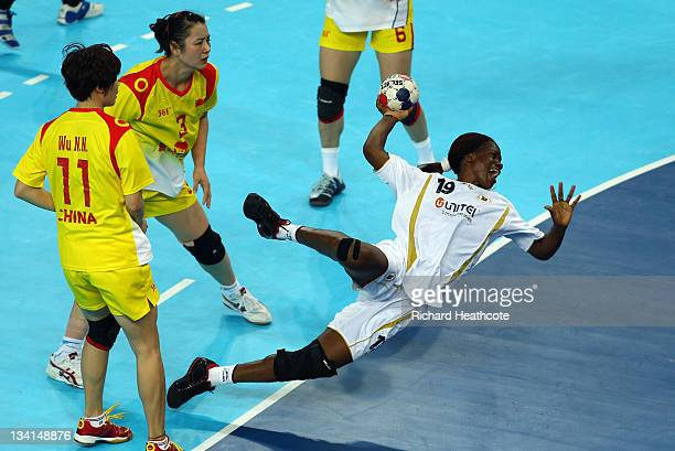 Bombo Madalena Calandula of Angola scores a goal in the Bronze Medal match between Angola and China during the London Handball Cup Finals at the...