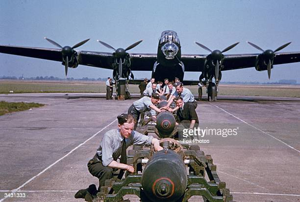Bombs being loaded onto a British Airforce AVRO Lancaster Bomber during World War II, circa 1943.