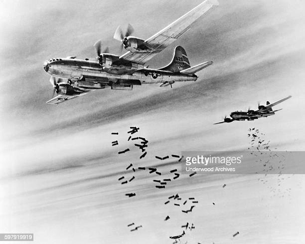 Bombs cascade from the bomb bay doors of B29 Superfortresses during a raid on the Japanese supply depots near the Mingaladon Air Field Burma February...