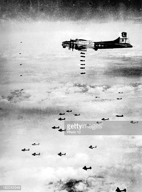 Bombs fall over German installations at Stuttgart as B17 Flying Fortresses of the 8th US Air Force complete a mission July 16 1944