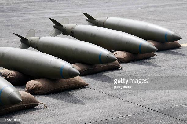 bombs lined up - shock tactics stock pictures, royalty-free photos & images