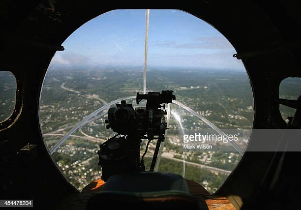 A bombsight is mounted on the nose of the World War II Era Boeing B17 nicknamed Memphis Belle as it flies over the Virginia countryside on September...