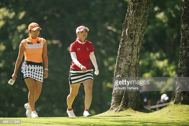 BoMee Lee of South Korea and Erika Kikuchi of Japan smile during the first round of the meiji Cup 2016 at the Sapporo Kokusai Country Club on July 31...