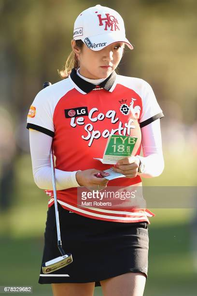 BoMee Lee of South Korea checks her yardage book on the 7th green during the first round of the World Ladies Championship Salonpas Cup at the Ibaraki...