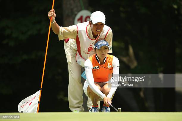 BoMee Lee of South Korea lines up her birdie putt on the 16th green during the final round of the Daito Kentaku Eheyanet Ladies 2015 at the Narusawa...