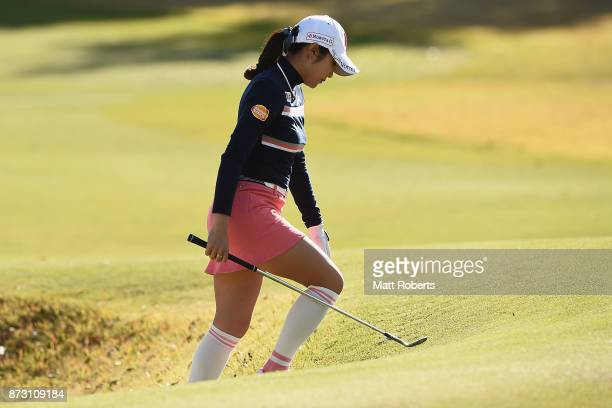 BoMee Lee of South Korea looks dejected as she walks out of the 15th green bunker during the final round of the Itoen Ladies Golf Tournament 2017 at...