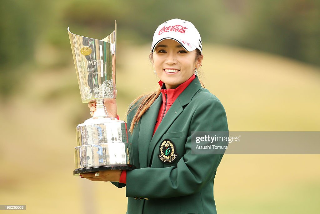 Bo-Mee Lee of South Korea poses with the trophy after winning the Daio Paper Elleair Ladies Open 2015 at the Itsuura-teien Country Club on November 22, 2015 in Iwaki, Japan.
