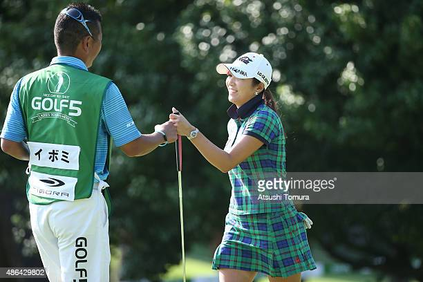 BoMee Lee of South Korea reacts after making her birdie putt on the 18th green during the first round of the Golf 5 Ladies Tournament 2015 at the...