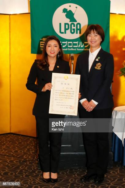BoMee Lee of South Korea receives a certificate from LPGA president Hiromi Kobayashi during the Ladies Professional Golfers' Association of Japan...