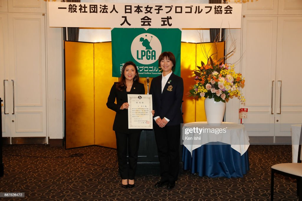 Bo-Mee Lee (L) of South Korea receives a certificate from LPGA president Hiromi Kobayashi during the Ladies Professional Golfers' Association of Japan induction ceremony at Hotel Monterey Ginza on December 7, 2017 in Tokyo, Japan.