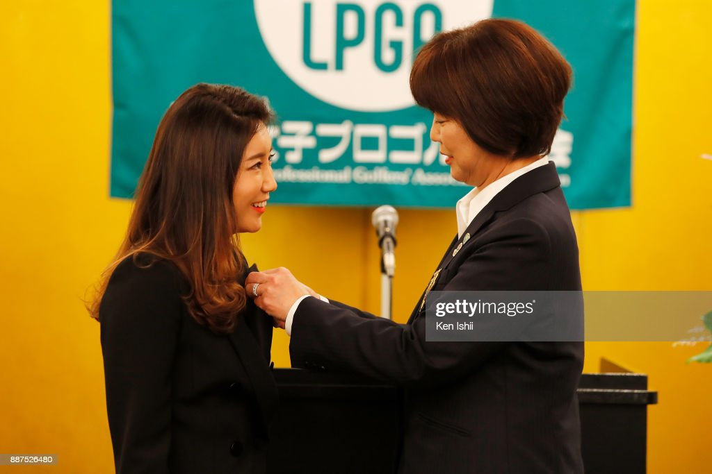 Bo-Mee Lee of South Korea receives a lapel pin from LPGA president Hiromi Kobayashi during the Ladies Professional Golfers' Association of Japan induction ceremony at Hotel Monterey Ginza on December 7, 2017 in Tokyo, Japan.