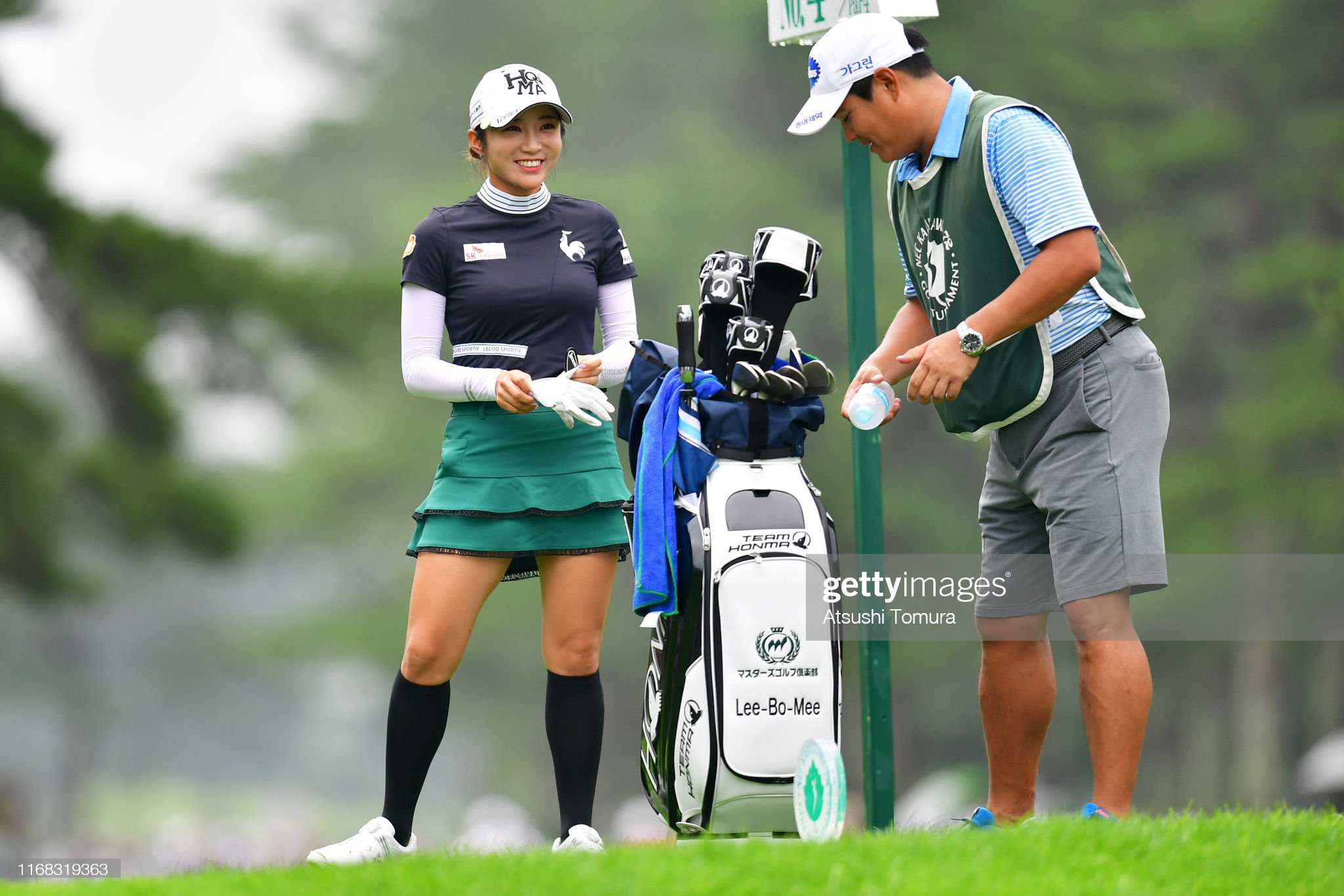 https://media.gettyimages.com/photos/bomee-lee-of-south-korea-smiles-while-talking-with-her-caddie-on-the-picture-id1168319363?s=2048x2048