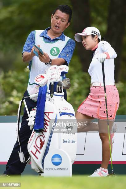 BoMee Lee of South Korea speaks with her caddie during the third round of the 50th LPGA Championship Konica Minolta Cup 2017 at the Appi Kogen Golf...