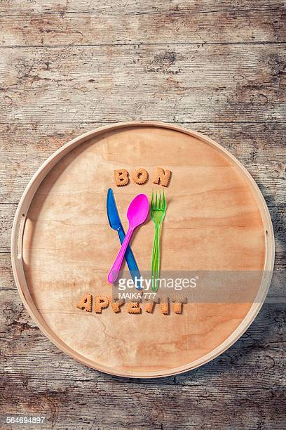 Bon appetit spelled with cookies & plastic cutlery