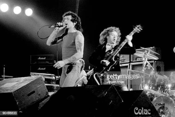 Bon Scott and Angus Young from AC/DC perform live on stage in Copenhagen Denmark in April 1977