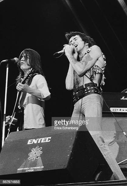 Bon Scott and Malcolm Young of AC/DC perform on stage Reading Festival Reading United Kingdom 29th August 1976