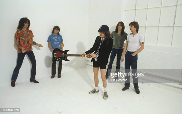 Bon Scott Malcolm Young Angus Young Cliff Williams and Phil Rudd of Australian rock band AC/DC pose in London England in August 1979