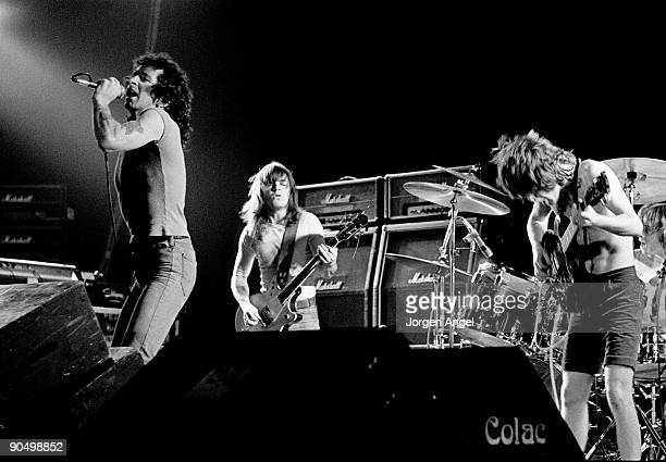 Bon Scott Malcolm Young Angus Young Phil Rudd from AC/DC perform live on stage in Copenhagen Denmark in April 1977