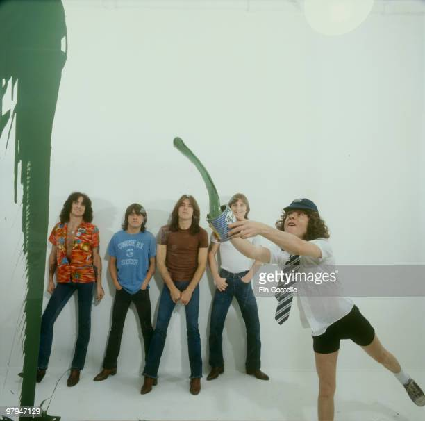 Bon Scott Malcolm Young Cliff Williams Phil Rudd and Angus Young of Australian rock band AC/DC pose in Camden London in August 1979
