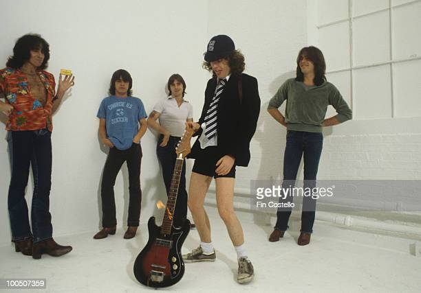 Bon Scott Malcolm Young Phil Rudd Angus Young and Cliff Williams of Australian rock band AC/DC pose in London England in August 1979