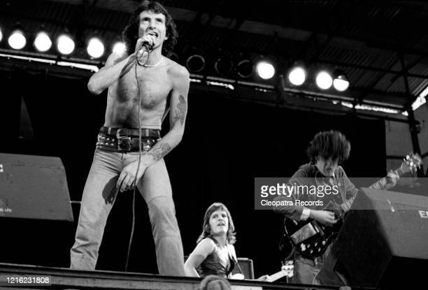 Bon Scott, Mark Evans, Angus Young from the rock band AC/DC Live at Reading Festival In Reading, UK August 29, 1976