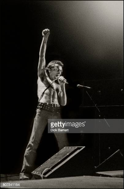 Bon Scott of AC/DC performing on stage, Lyceum Theatre, London, United Kingdom on July 7, 1976 from the Lock Up Your Daughters Tour.