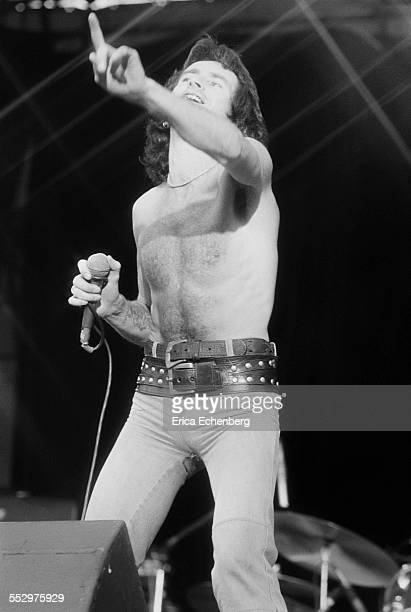 Bon Scott of AC/DC performs on stage, Reading Festival, Reading, United Kingdom, 29th August 1976.