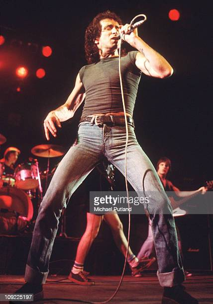 Bon Scott performs on stage with AC/DC UK 1976