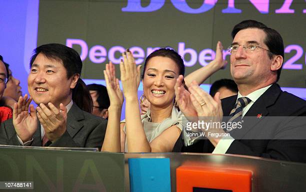 Bona CEO Dong Yu actress Gong Li and NASDAQ President and CEP Robert Greifeld ring the opening bell at the NASDAQ MarketSite on December 9 2010 in...