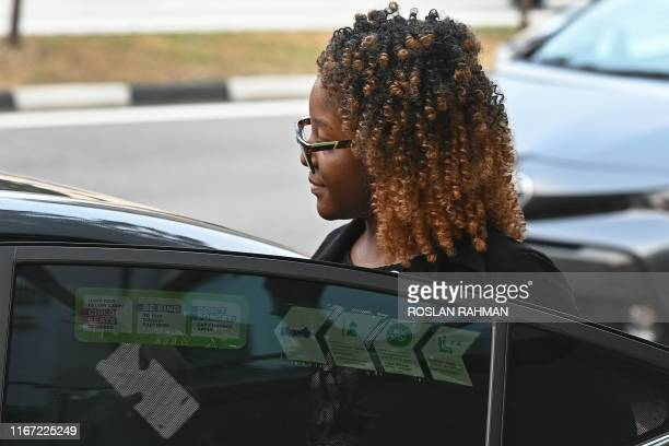 Bona Mugabe daughter of late former Zimbabwe president Robert Mugabe leaves the Singapore Casket building in Singapore on September 10 where the body...
