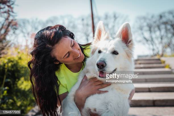 bond between a girl and her dog - off leash dog park stock pictures, royalty-free photos & images