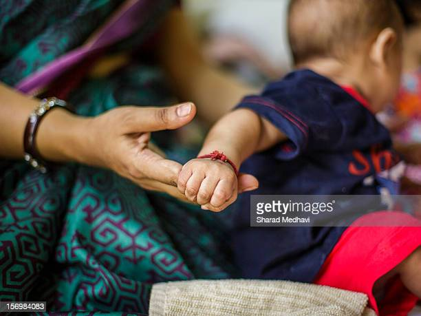 bond between the mother and child - indian baby stock photos and pictures