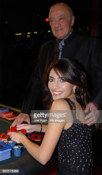 Bond girl Caterina Murino who stars in Casino Royale appears with Mohammed Al Fayed at Harrods in central London as part of the James Bond themed...