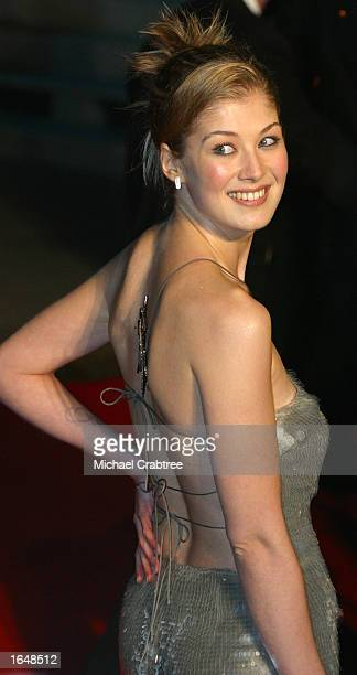Bond girl Rosamund Pike arrives for the world premiere of Die Another Day at the Royal Albert Hall in the presence of Britain's Queen and the Duke of...