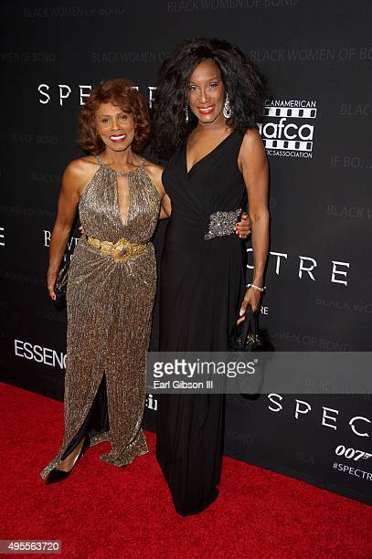 Bond Girls Gloria Hendry and Trina Parks attend SpectreThe Black Women of Bond tribute at California African American Museum on November 3 2015 in...