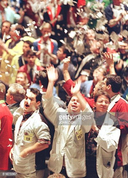 Bond traders at the Chicago Board of Trade toss trading slips into the air at the close of trading for the year 31 December in Chicago IL The markets...