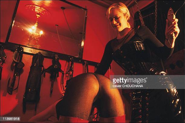 Bondage school in Sydney Australia In 2005Mistress Gala demonstrates a whipping technique during a bondage workshop at the Kastle bondage brothel in...