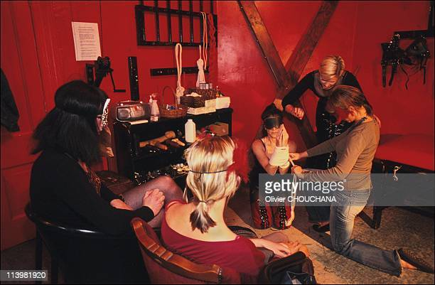 Bondage school in Sydney Australia In 2005Mistress Gala shows her students how to correctly tie up a slave with a Kmart clothes line