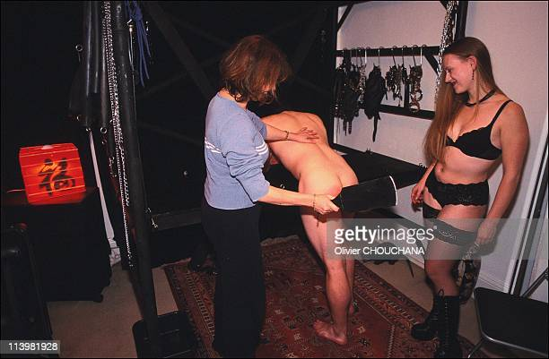 Bondage school in Sydney Australia In 2005Slave Robert offers his backside for a demonstration of hand and paddle spanking in Mistress J's dungeon