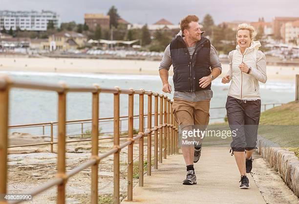 Bondi Beach Mature Couple Running Together Sydney