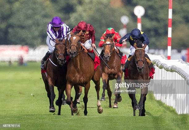 Bondi Beach ridden by Colm O' Donoghue and Simple Verse ridden by Andrea Atzeni clash during The Ladbrokes St Leger Stakes at Doncaster Racecourse on...