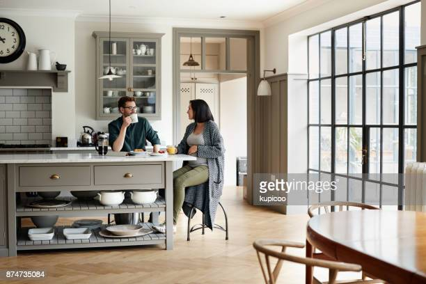 bonding around the breakfast table - young couple stock pictures, royalty-free photos & images